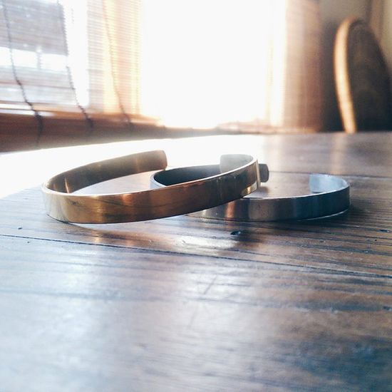 | The 'silver' and 'gold' Hand Forged in Zimbabwe Cuffs. Hand-Finished, Quality Tested available this Friday @ www.theradblackkids.com | Cuffs Handmade Jewelry Unisex zimbabwe bespoke dapper forged bracelets oneforone sblogger fblogger streetwear streetstyle streetfashion losangeles california nyc paris southafrica beautiful limitededition alloy menswear womenswear luxury