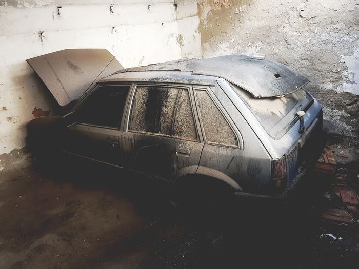 High angle view of abandoned car on wall