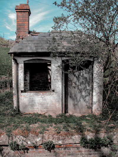 a little hut Hut Little House Cottage Tiny Cottage Victorian Architecture Derelict Chimney Cirrus Clouds Wales UK Remnants Canals And Waterways Abandoned Architecture Building Exterior Sky Built Structure Entryway Closed Entry Door Entrance Arched Closed Door Front Door Weathered