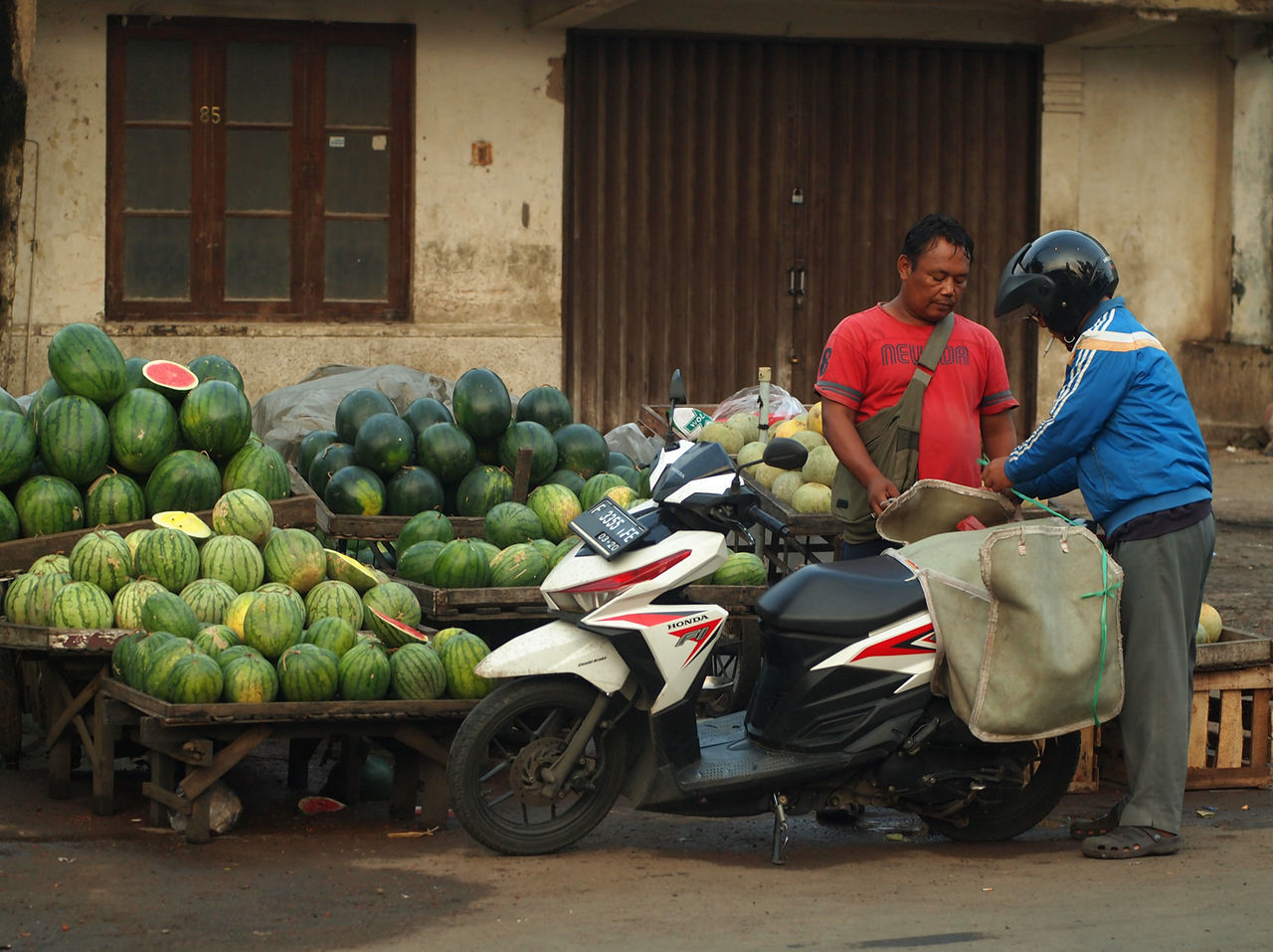 real people, two people, day, transportation, outdoors, motorcycle, building exterior, fruit, built structure, young women, helmet, young adult, togetherness, women, men, architecture, adult, people