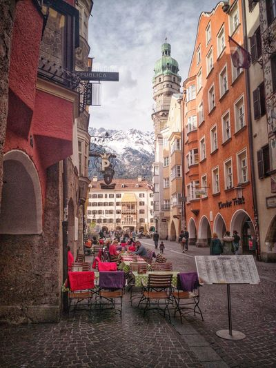 City Life Architecture Building Urban Europe Western Europe Culture Goldendach Innsbruck Tirol  Austria Österreich Turm Golden Tower City Chair Sky Architecture Building Exterior Built Structure Sidewalk Cafe Town Square Old Town People In The Background TOWNSCAPE Settlement Cityscape Cafe Town Hall