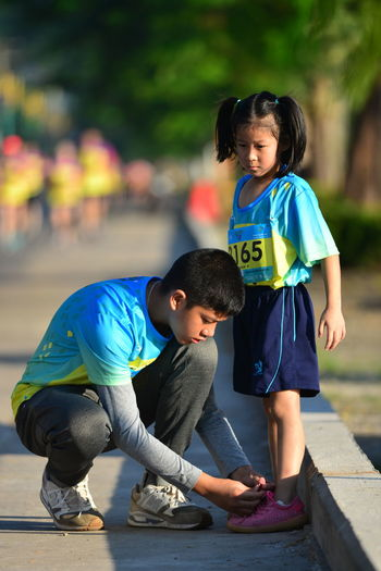 Thailand new fun run runners siblings New 10k Runners New Runners New Runners New Running Shoes A New Beginning Boys Casual Clothing Child Childhood Focus On Foreground Full Length Innocence Leisure Activity Lifestyles Males  Men New Runner Outdoors People Real People Togetherness Human Connection