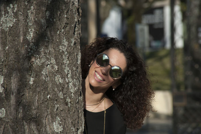 Adult Adults Only Camera - Photographic Equipment Close-up Day Digital Single-lens Reflex Camera Eyeglasses  Headshot Human Eye One Person One Woman Only One Young Woman Only Outdoors People Photography Themes Portrait Smiling Sunglasses Tree Women Young Adult