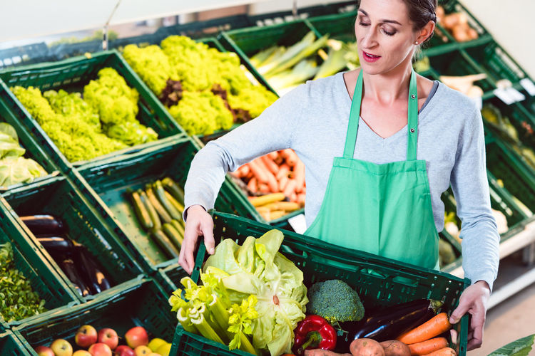 Midsection of woman standing at market stall