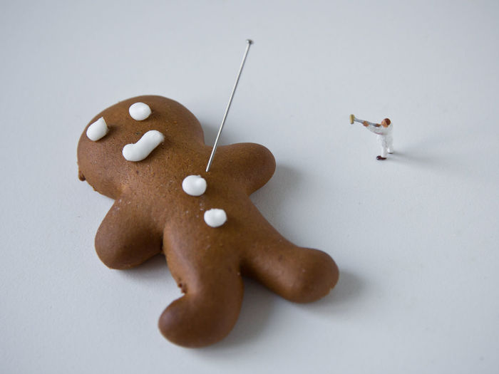 Anthropomorphic Face Brown Christmas Close-up Cookie Day Figurine  Food Food And Drink Freshness Gingerbread Man High Angle View Human Representation Indoors  Male Likeness No People Ready-to-eat Still Life Studio Shot Sweet Food Table White Background