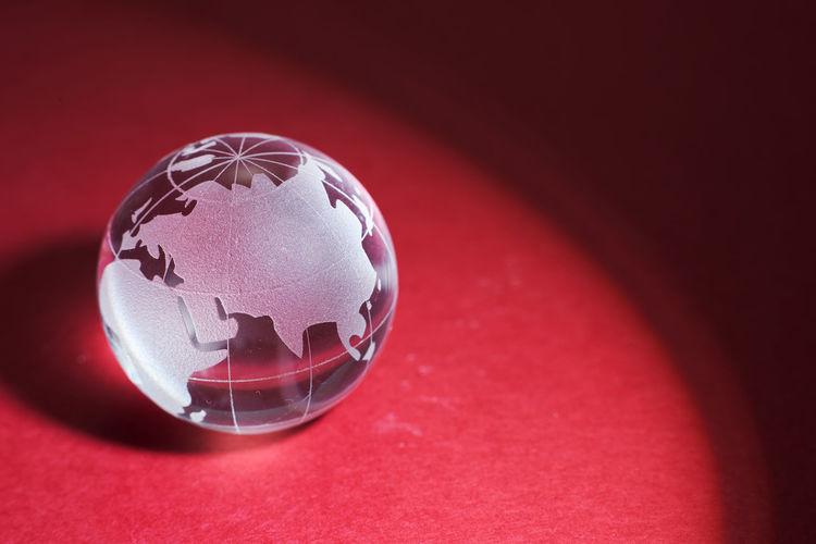 High angle view of glass ball on table