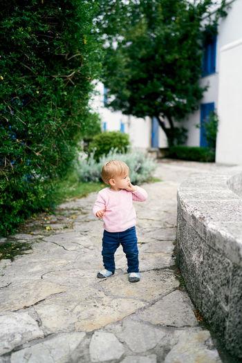 Full length of cute baby walking on footpath