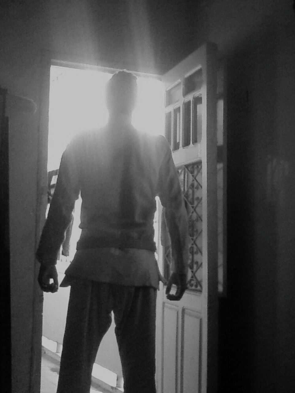 one person, rear view, real people, standing, indoors, doorway, home interior, day, lifestyles, men, architecture, adult, people