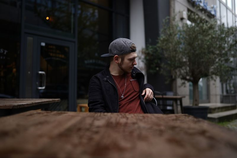 Man sitting at table in city