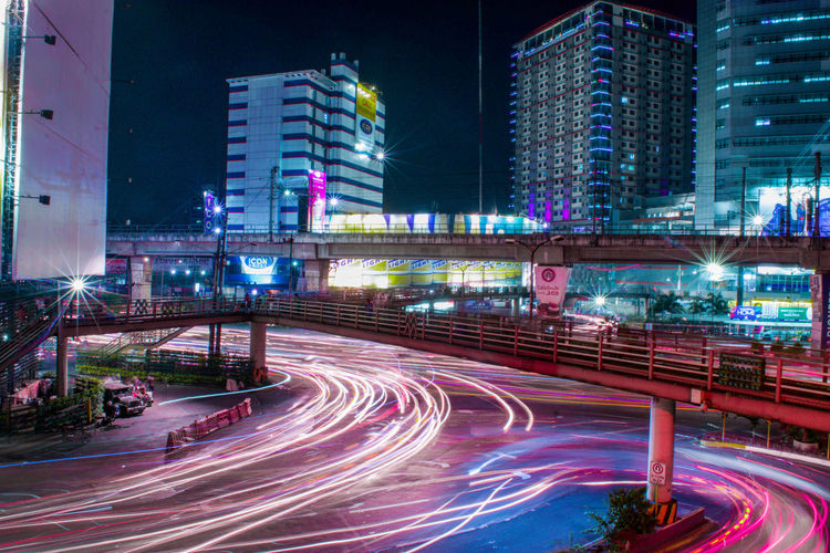 Streets of Manila Long Exposure Neon City Cityscape Urban Skyline Illuminated Modern Skyscraper Road Futuristic Multi Colored Downtown District Neon Colored Fluorescent Rush Hour Traffic Circle Traffic Jam Multiple Lane Highway Tail Light Highway Overpass Vehicle Light First Eyeem Photo