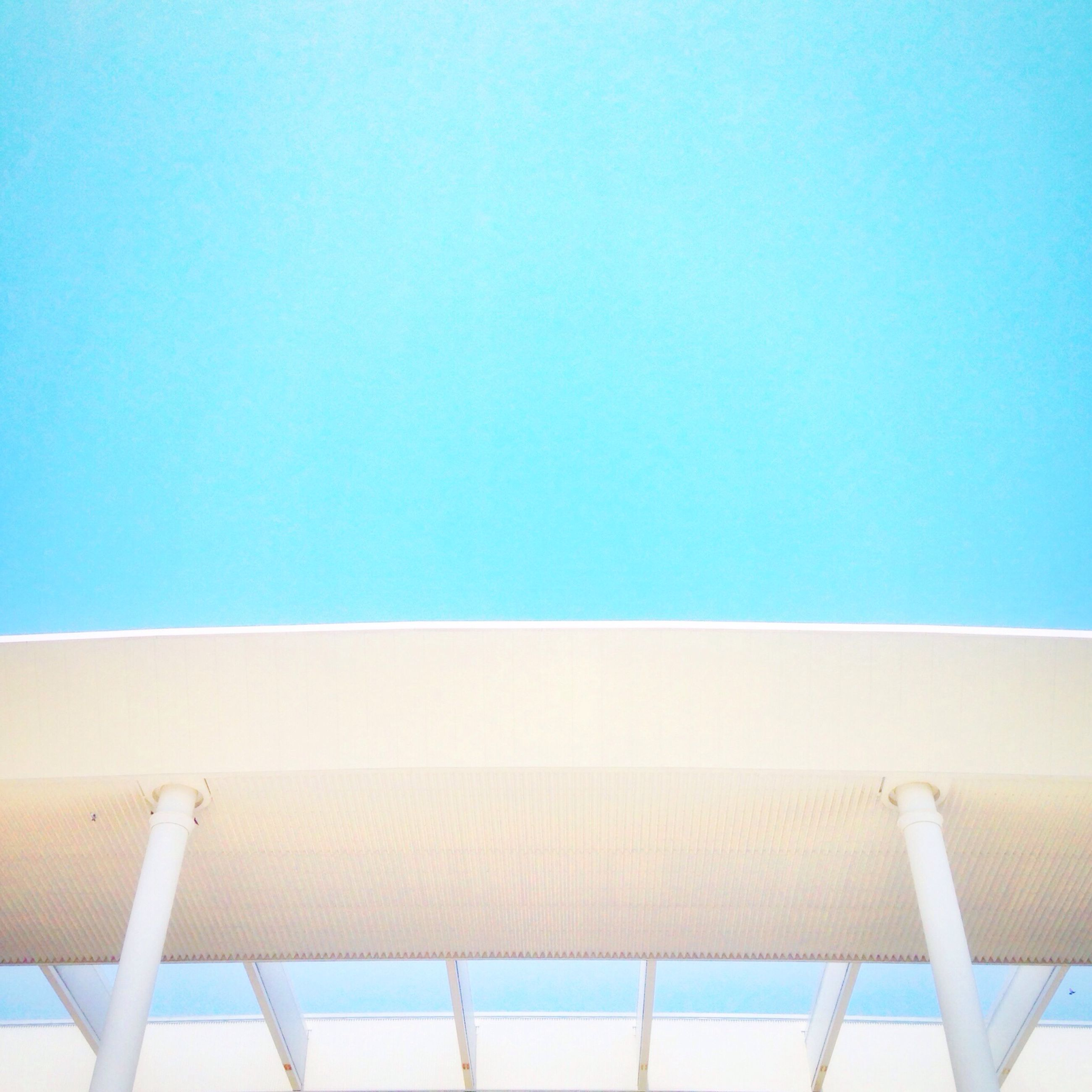 low angle view, clear sky, blue, copy space, built structure, architecture, day, no people, outdoors, sky, nature