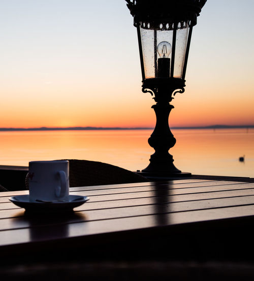 End of the day Sunset Sky Table No People Silhouette Food And Drink Orange Color Nature Water Close-up Outdoors Glass - Material Refreshment Sea Glass Household Equipment Drink Still Life