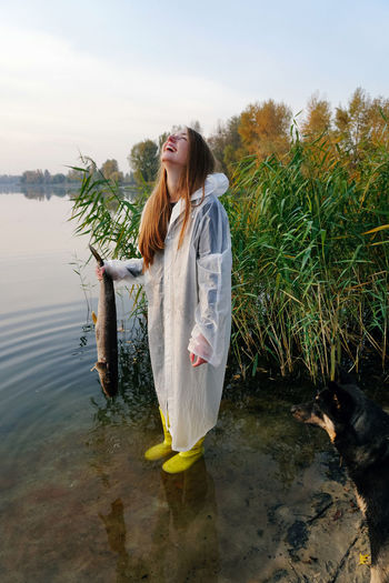 Real People Lifestyles Outdoors Nature Young Adult One Person Young Women Water Laughing Laugh Girl Fish Fishing Lake Lake View Autumn Leisure Activity Fun Fisherman Nature Raincoat Dog Redhead Red Hair Fall International Women's Day 2019
