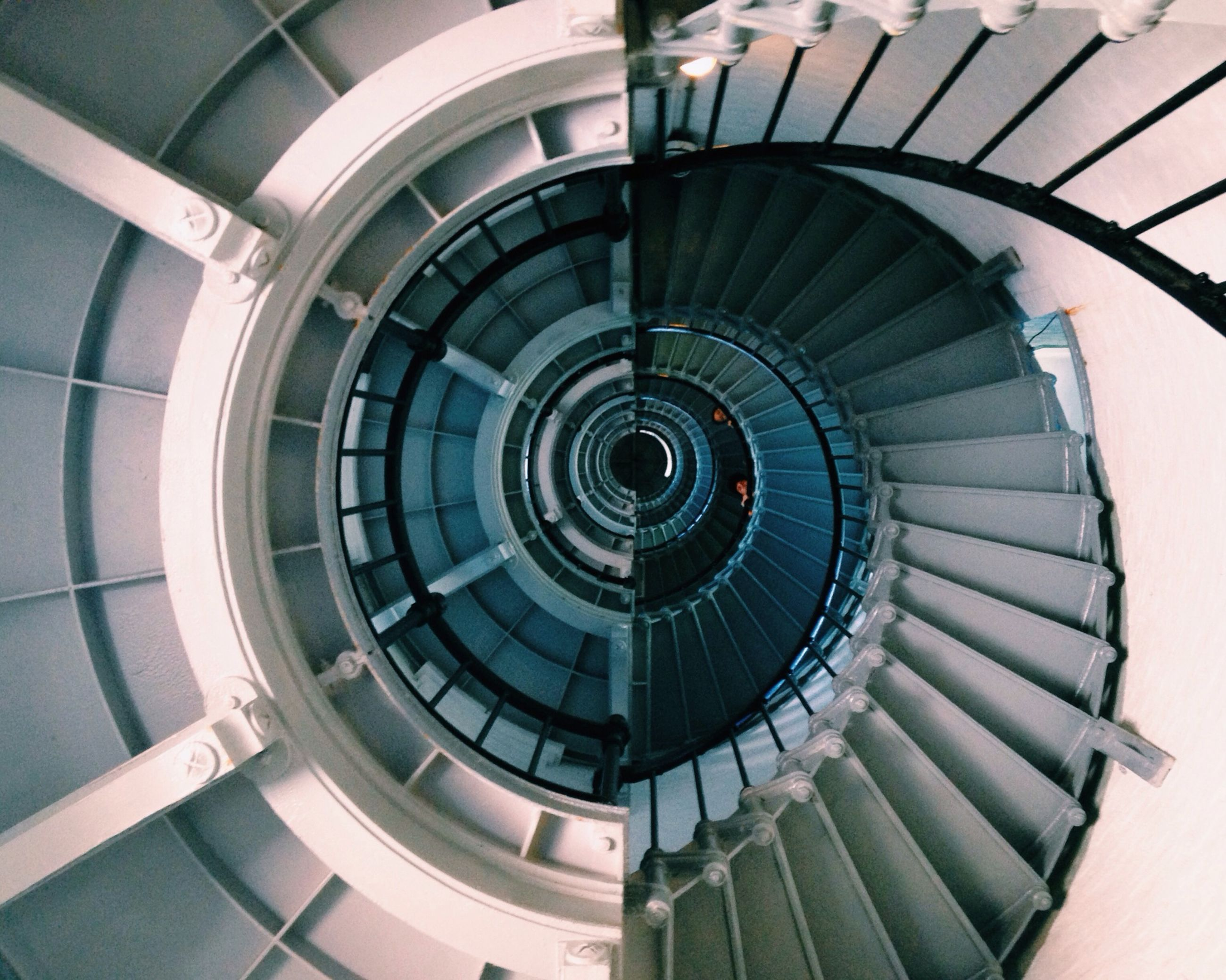steps and staircases, staircase, spiral staircase, steps, spiral, architecture, built structure, railing, indoors, pattern, modern, directly below, building exterior, circle, building, low angle view, stairs, high angle view, architectural feature, design