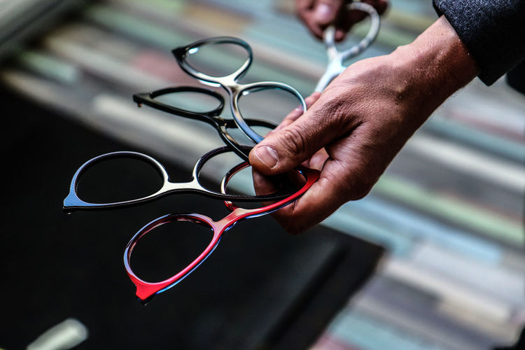 Close-up of man holding eyeglasses