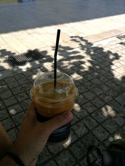 Frappe Greek Drink Human Hand Drink Drinking Glass Low Section Shadow Holding Drinking Straw Personal Perspective Close-up Food And Drink Iced Coffee