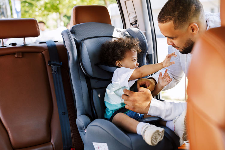 Father with son sitting in car