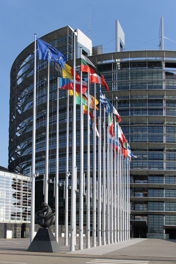 European Parliament in Strasbourg, France Building Exterior Architecture Built Structure City Building Flag Modern Office Building Exterior Day Office Glass - Material Sky Outdoors No People Low Angle View Sunlight Window Government European Union European Parlament European Parliament
