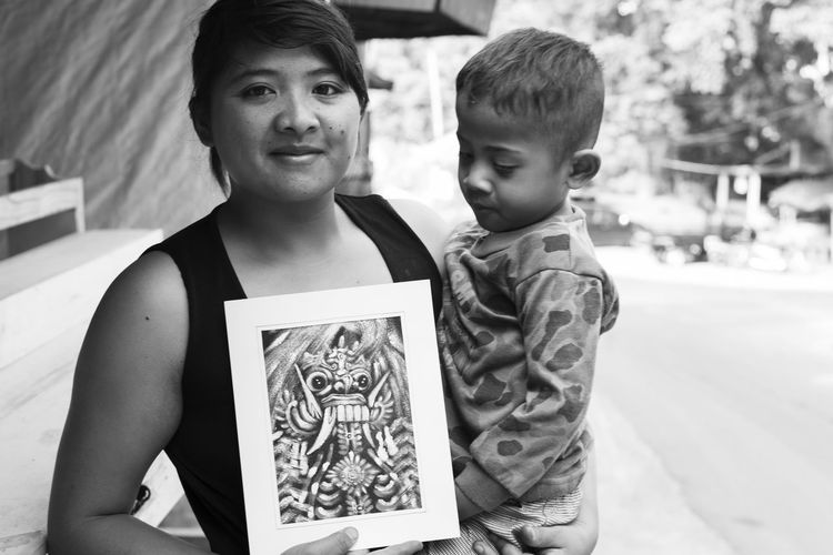 this is bali Women Who Inspire You Bali Mother's Day Portrait Of A Woman Sentimental Street Portrait Balinese Black And White Caring Loving Kindness Monochrome Mother And Child Smiling Street Photography Togetherness Traditional Art Woman Holding Child Young Boy