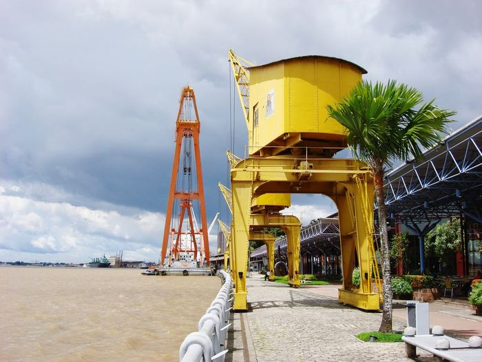 Low angle view of crane on beach against sky