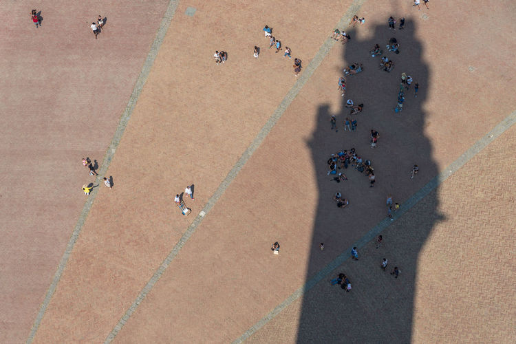 High angle view of people on town square in city during sunny day