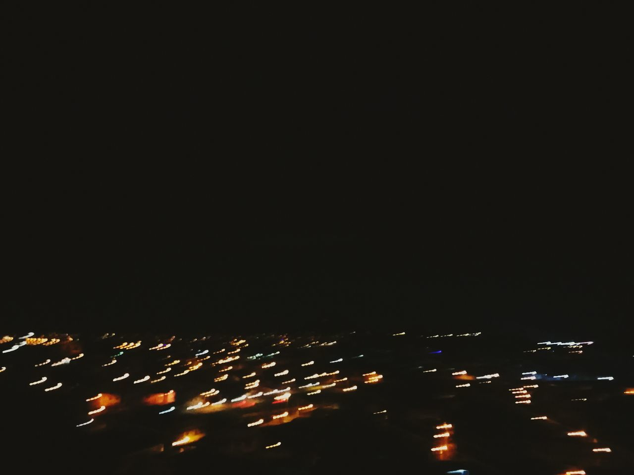 illuminated, night, copy space, city, no people, high angle view, outdoors, cityscape, architecture, black background, sky