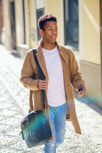 Full length of young man walking on street