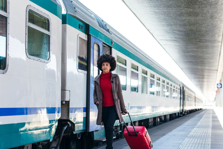 Portrait of woman on train at railroad station
