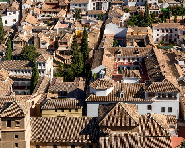 Tiled roofed houses in the lower part of the Albayzin neighborhood, Granada, Spain Architecture Building Exterior Built Structure City City Life Cityscape Community Crowded Day Development Granada, Spain High Angle View House Houses Housing Settlement Human Settlement No People Residential Building Residential District Residential Structure Roof Rooftop Town