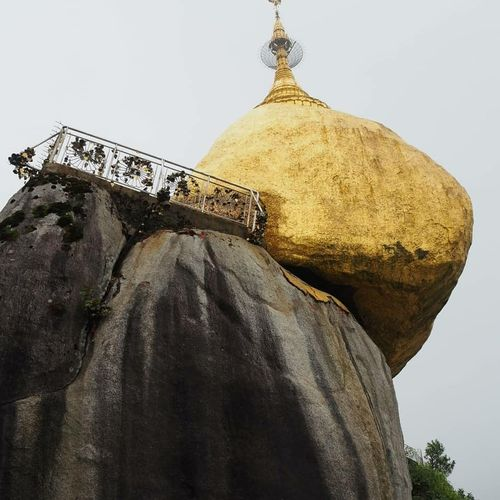 Religion Belief Sky Spirituality Nature Low Angle View Place Of Worship Architecture No People Rock Day Built Structure Solid Gold Colored Human Representation Outdoors Spire  Goldenrock Myammar