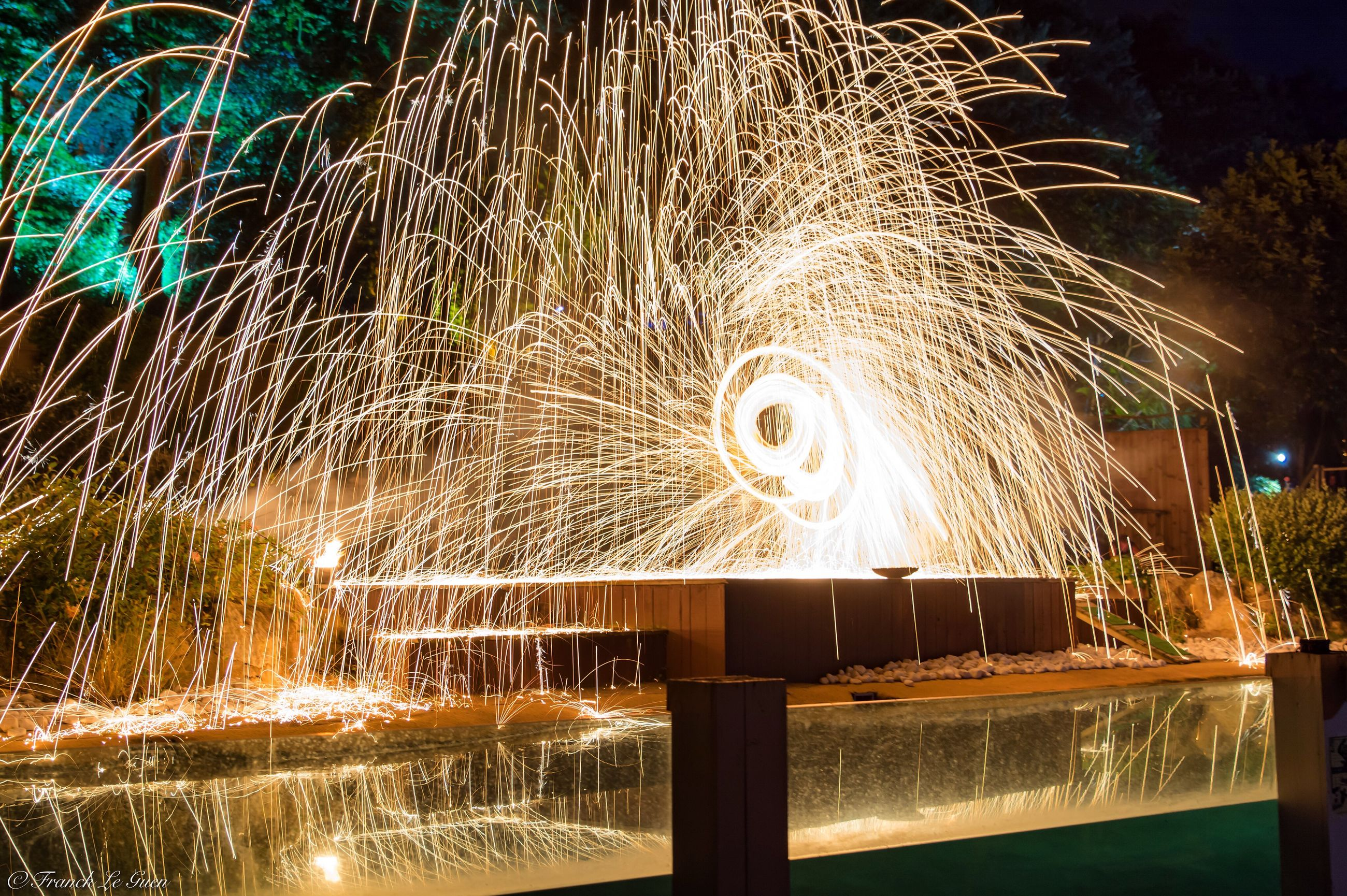 illuminated, night, long exposure, motion, glowing, water, lighting equipment, sparks, firework display, blurred motion, arts culture and entertainment, celebration, exploding, light trail, light, outdoors, sky, no people, firework, entertainment, lit