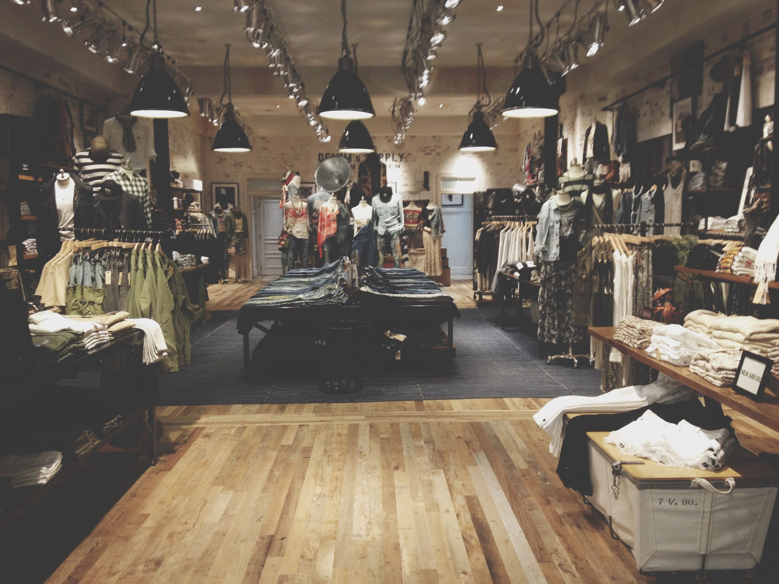 indoors, table, architecture, built structure, wood - material, illuminated, large group of objects, hanging, lighting equipment, in a row, retail, ceiling, incidental people, arrangement, store, chair, no people, absence, empty, day
