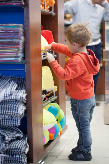 Boy Buyer Caucasian Childhood Cute Engrossed Grocery Kid Sale Selecting Shop Shopper Shopping Sideways Small Supermarket Toy Young