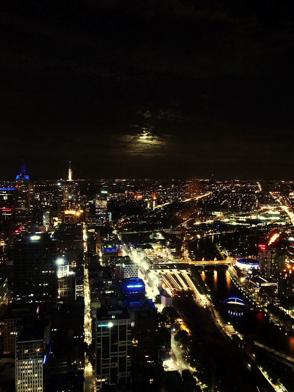 city, building exterior, illuminated, night, architecture, cityscape, built structure, sky, building, crowded, high angle view, modern, residential district, city life, glowing, nature, office building exterior, skyscraper, outdoors, financial district, nightlife