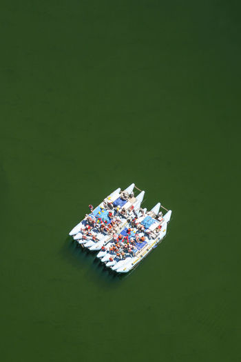 Aerial view of people in boat at river
