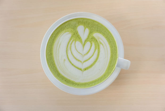 ArtWork Coffee Holiday Recreation  Close-up Coffee Break Coffee Cup Drink Food Food And Drink Freshness Froth Art Frothy Drink Green Color Green Tea Healthy Eating High Angle View Indoors  Matcha Tea Mutcha No People Refreshment Table Wooden Wooden Texture