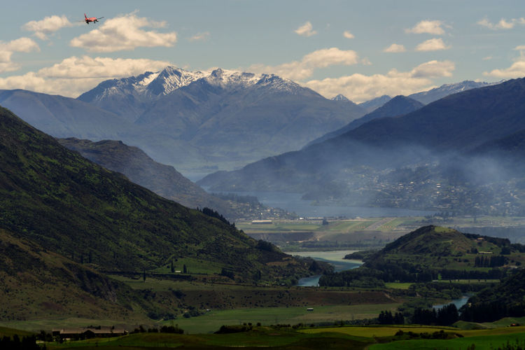 Agriculture Airplane Airport Cloud - Sky Day Frankton Landscape Mountain Mountain Range Nature New Zealand No People Outdoors Queenstown Airport Scenics Smoke Valley Village