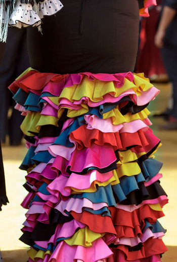 Midsection of woman wearing multi colored dress