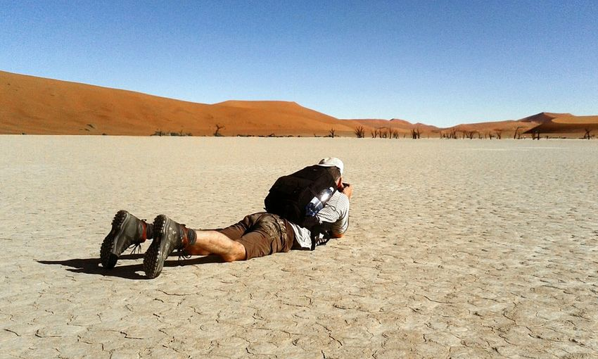 Rear view of man lying on mountain