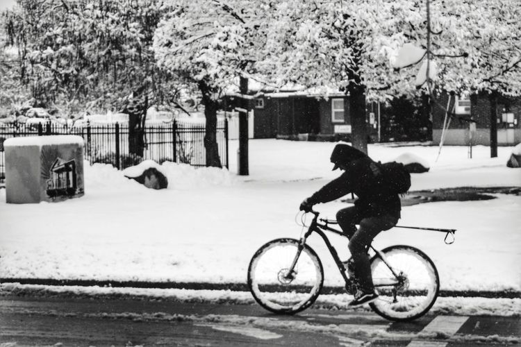 Snow Bicycle In The Snow Bicycle In The City Blackandwhite Man On Bike Bicycle Streetphotography Streetphoto_bw Street Photography Snowscene Riding Bike