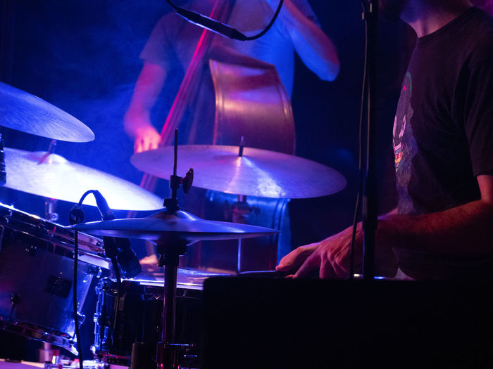 Concert Photography: Jazz Instruments: Drumkit Music Real People Occupation Arts Culture And Entertainment Musical Instrument Performance Musical Equipment Men Musician Skill  Illuminated Night Artist Drum - Percussion Instrument Midsection Nightlife People Playing Percussion Instrument Stage Concert Entertainment Occupation Jazz Concert