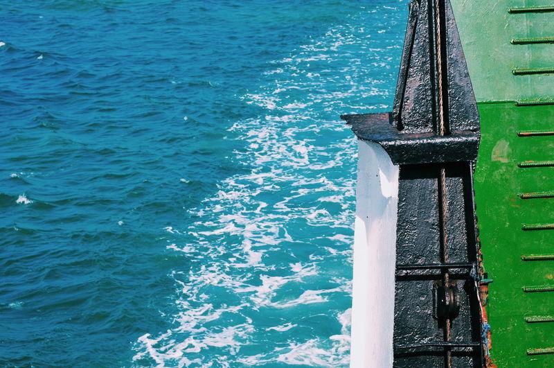 High angle view of metallic boat in sea