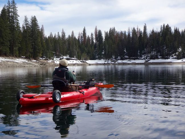 Fishing for rainbow trout at Shaver Lake, California Adventure Aquatic Sport Beauty In Nature Cold Temperature Fishing Kayak Kayak Fishing Kayaking Lake Leisure Activity Men Nature Outdoor Pursuit Outdoors Snow Tree Water Weekend Activities