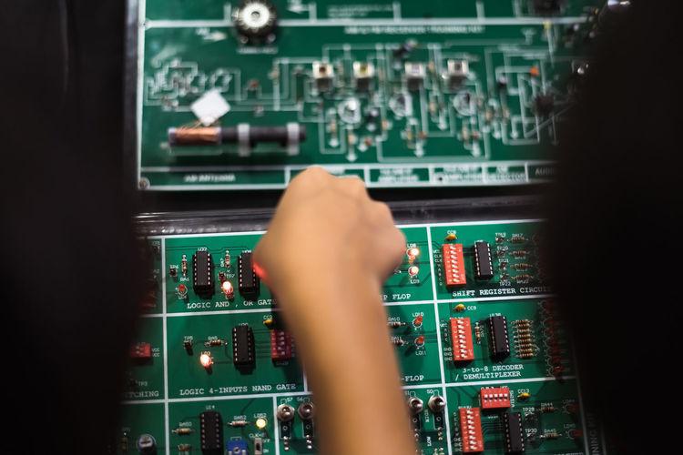 Cropped hand repairing circuit board
