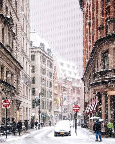 Cars on city street during winter