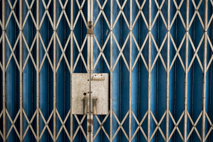 Full frame shot of closed metallic gate