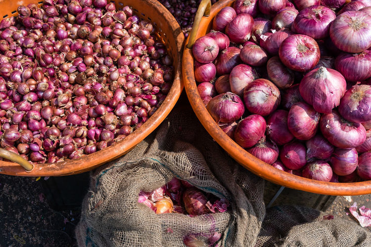 High angle view of onions in market stall