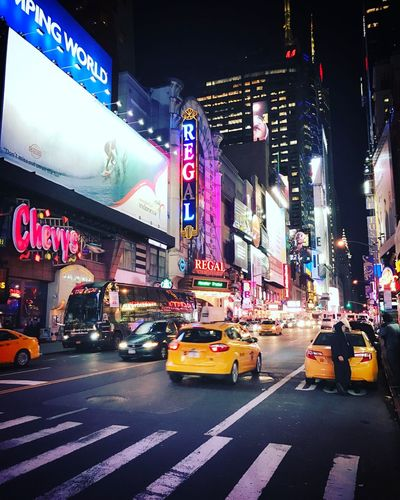 Illuminated Architecture Night Building Exterior City Car Transportation City Life Street Travel Destinations Yellow Taxi Built Structure Outdoors Mode Of Transport Large Group Of People Nightlife Road Neon Real People Crowd New York City
