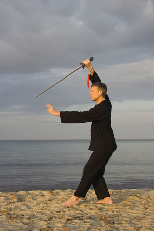tai chi - posture small star - art of self-defense Beach Exercise Exercising Fitness Fitness Training Full Length Healthy Lifestyle Holding Horizon Over Water Man Martial Arts Mature Men Men One Man Only One Mature Man Only Outdoors Sea Side View Sunset Sword Tai Chi Tai Chi Chuan Taiji Taijiquan Water