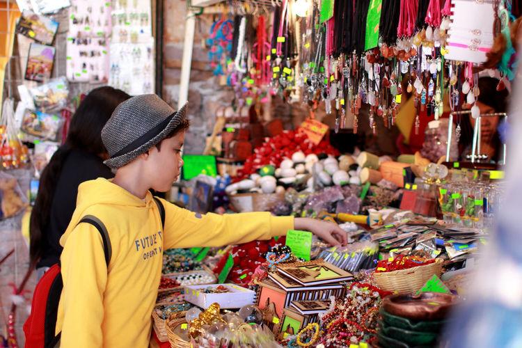 Boy shopping in city market
